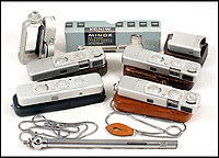 BNPS.co.uk (01202 558833)Pic: Astons/BNPS<br /> <br /> Mighty Minox collection.<br /> <br /> Cold War Collectables - Auction of Soviet spy camera's from behind the Iron Curtain reveal the KGB's cunning and ingenuity at the height of the Cold War.<br /> <br /> A fascinating collection of Russian spy cameras which were used clandestinely at the height of the Cold War have emerged for sale for &pound;60,000.<br /> <br /> The ingenious gadgets deployed by KGB operatives include cameras built into the sides of briefcases, buttons of jackets, umbrella handles and cigarette cases.<br /> <br /> The sale also features a clever 'Zenit' F-21 spy camera which shoots photos through the side of a camera case when it appears to be shut.<br /> <br /> There are also several 'Minox' cameras which are known as the 'James Bond' spy camera as one appeared in the film On Her Majesty's Secret Service (1969).