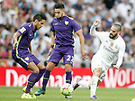 Real Madrid's Isco (r) and Malaga's Jose Luis Garcia Recio (l) and Adnane Tighadouini during La Liga match. September 26,2015. (ALTERPHOTOS/Acero)
