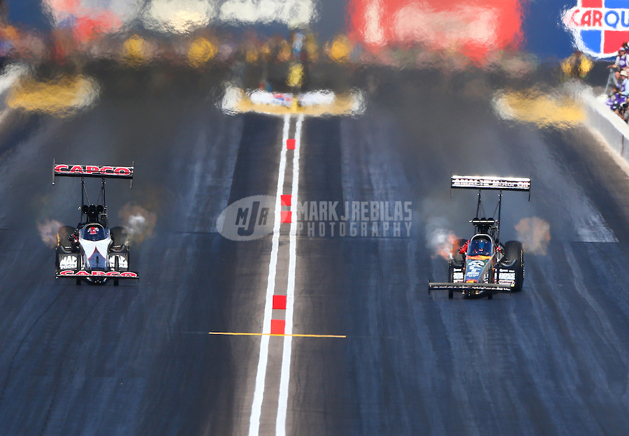 Feb 28, 2016; Chandler, AZ, USA; NHRA top fuel driver Steve Torrence (left) races alongside Terry McMillen during the Carquest Nationals at Wild Horse Pass Motorsports Park. Mandatory Credit: Mark J. Rebilas-
