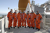 Cape Canaveral, FL - January 21, 2009 -- After practicing emergency egress from the pad, the STS-119 crew members pose on the 225-foot level for a crew photo. From left are Mission Specialists Richard Arnold and Steve Swanson, Pilot Tony Antonelli, Commander Lee Archambault, and Mission Specialists Koichi Wakata, John Phillips and Joseph Acaba. The crew also took part in a simulated launch countdown, part of the prelaunch preparation known as Terminal Countdown Demonstration Test. The TCDT also includes equipment familiarization. Discovery is targeted to launch on the STS-119 mission February 27, 2009. During the 14-day mission, the crew will install the S6 truss segment and solar arrays to the starboard side of the International Space Station, completing the station's truss, or backbone. .Credit: Kim Shiflett - NASA via CNP