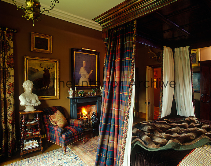 Queen Victoria would probably have felt at home in this bedroom where the antique four-poster bed has been hung with tartan curtains and the room is filled with 19th-century furniture and paintings
