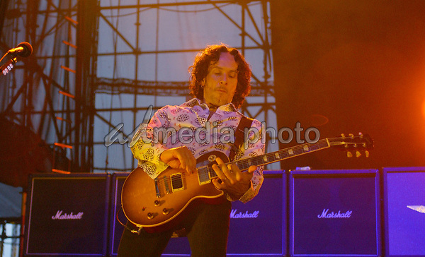 """23 June 2005 - Pittsburgh, PA. - Vivian Campbell of the band 'Def Leppard' performs during a tour stop on their """"25th Anniversary Tour"""" held at the Chevrolet Ampitheater at Station Square. Photo Credit: Laura Farr/AdMedia"""