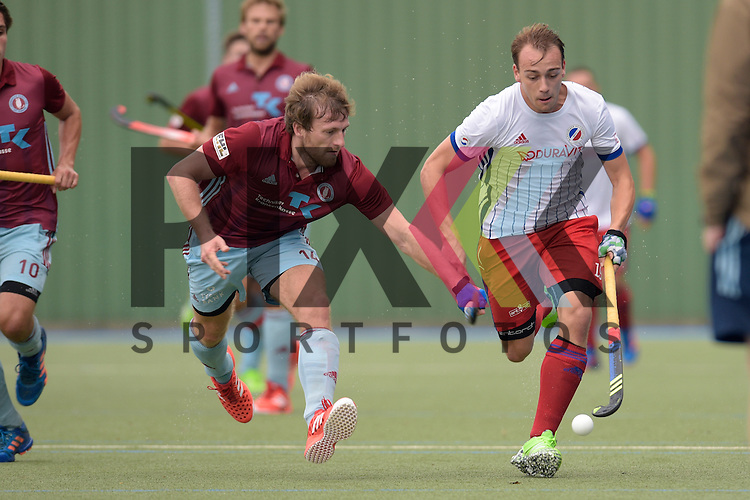 GER - Mannheim, Germany, September 18: During the men hockey match between Mannheimer HC (white) and UHC Hamburg (purple) on September 18, 2016 at Mannheimer HC in Mannheim, Germany. Final score 7-0 (HT 3-0).  Jan-Philipp Rabente #14 of Uhlenhorster HC Hamburg, Felix Schues #19 of Mannheimer HC<br /> <br /> Foto &copy; PIX-Sportfotos *** Foto ist honorarpflichtig! *** Auf Anfrage in hoeherer Qualitaet/Aufloesung. Belegexemplar erbeten. Veroeffentlichung ausschliesslich fuer journalistisch-publizistische Zwecke. For editorial use only.