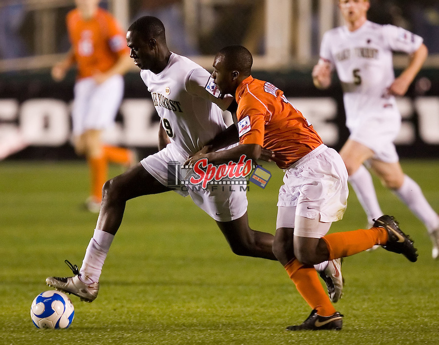 Marcus Tracy (9) of the Wake Forest Demon Deacons tries to keep the ball away from Bryan Collier (16) of the Virginia Tech Hokies in semi-final action of the 2007 NCAA Men's College Cup at SAS Soccer Park in Cary, NC, Friday, December 14, 2007.  The Demon Deacons defeated the Hokies 2-0 to advance to the finals versus Ohio State.