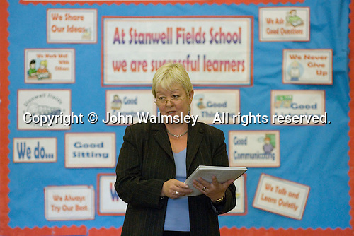 State Primary School.  Head Teacher talking in assembly.