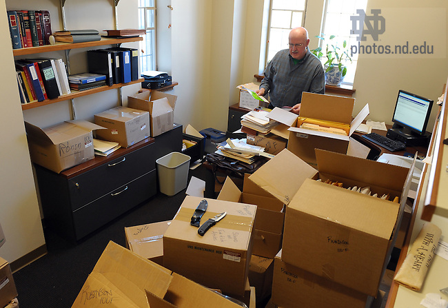 Professor John Robinson unpacks in his office...Photo by Matt Cashore/University of Notre Dame