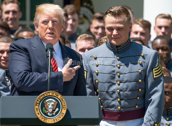 United States President Donald J. Trump recognizes defensive lineman and co-Captain John Voit (59) as he presents the Commander-in-Chief's Trophy to the U.S. Military Academy football team in the Rose Garden of the White House in Washington, DC on Tuesday, May 1, 2018.  The Commander-in-Chief's trophy is presented to the winner of the annual Army-Navy football game which was played at Lincoln Financial Field in Philadelphia, Pennsylvania on December 9, 2017.  The Army Black Knights beat the Navy Midshipmen 14 - 13.<br /> Credit: Ron Sachs / CNP /MediaPunch