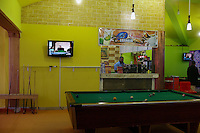 Ben Waled, Libya, March 23, 2011.In this image taken during an organized trip by the Libyan authorities, Libyan men play pool in a coffee shop as supporters of  Kaddhafi stage a spontaneous demonstration outside in Ben-Waled, home of the Warfallah tribe, 160kms (100 miles) south east of Tripoli.