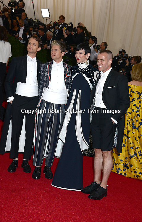 Neil Patrick Harris and partner David Burtka, Amy Fine Collins and Thom Browne attend the Costume Institute Benefit on May 5, 2014 at the Metropolitan Museum of Art in New York City, NY, USA. The gala celebrated the opening of Charles James: Beyond Fashion and the new Anna Wintour Costume Center.