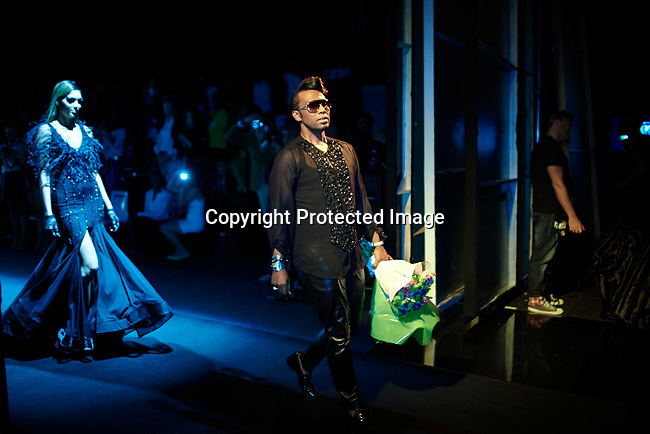 JOHANNESBURG, SOUTH AFRICA OCTOBER 26: The South African designer David Tlale walks out after finishing his show at Mercedes Benz Africa fashion week on October 26, 2012 held in Johannesburg, South Africa. African designers from around the continent showed their best fall/winter collections. Mr. Tlale is one of the most celebrated designers in South Africa. (Photo by: Per-Anders Pettersson)
