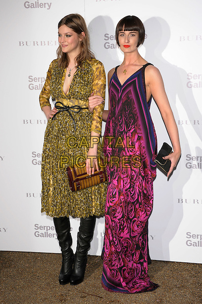 Amber Anderson, Erin O'Connor.Serpentine Gallery Summer Party, Kensington Palace Gardens, London 29th June 2011.full length yellow pink dress.CAP/PL.©Phil Loftus/Capital Pictures.