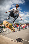 &copy; Joel Goodman . 22 June 2013 . Stockport RUFC ,<br /> Headlands Road , Bramhall , SK7 3AN , UK . CONNOR WHITE (26 , correct) from Macclesfield , jumps on his skateboard on the ramp . Music , activities and stalls at the Headlander Festival at Stockport RUFC . Photo credit : Joel Goodman