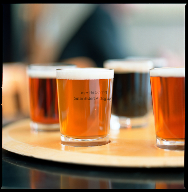 "a round of ""tasters"" from the Bridgeport Ale House in the Hawthorne Shopping District in SouthEast Portland."