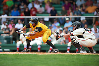 Jacksonville Suns outfielder Carlos Lopez (7) lays down a bunt in front of catcher Adrian Nieto during the 20th Annual Rickwood Classic Game against the Birmingham Barons on May 27, 2015 at Rickwood Field in Birmingham, Alabama.  Jacksonville defeated Birmingham by the score of 8-2 at the countries oldest ballpark, Rickwood opened in 1910 and has been most notably the home of the Birmingham Barons of the Southern League and Birmingham Black Barons of the Negro League.  (Mike Janes/Four Seam Images)