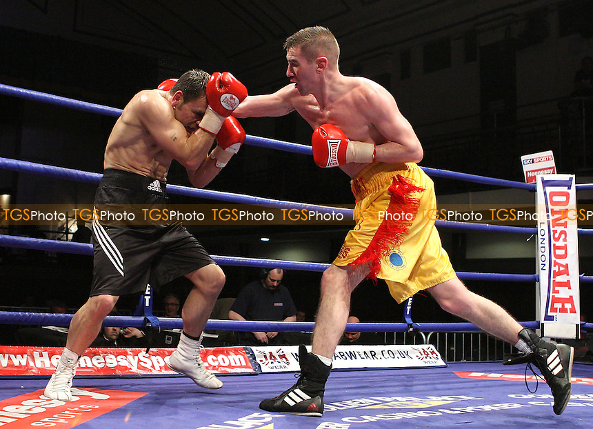 Dave Stewart (Ayr/Wanstead, yellow shorts) defeats Billy Smith (Stourport, black shorts) in a Lightweight contest at York Hall, promoted by Hennessy Sports - 22/02/08 - MANDATORY CREDIT: Gavin Ellis/TGSPHOTO. Self-Billing applies where appropriate. NO UNPAID USE. Tel: 0845 094 6026