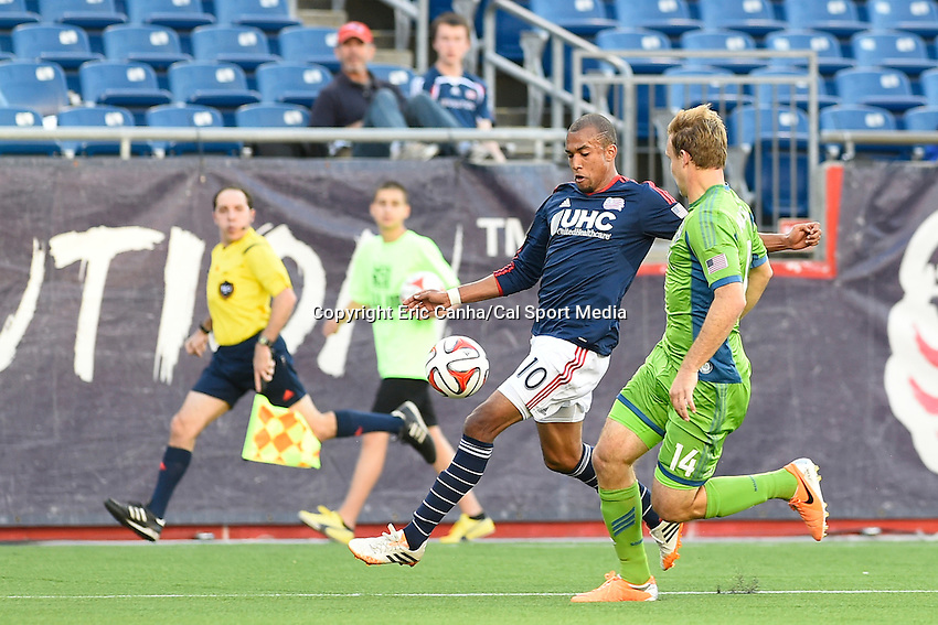 May 11, 2014 - Foxborough, Massachusetts, U.S. - during the MLS game between the Seattle Sounders FC and the New England Revolution held at Gillette Stadium in Foxborough Massachusetts.  New England defeated Seattle 5-0   Eric Canha/CSM