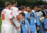 The Wycombe mascot shakes hands with Birmingham and Scotland International, Garry O'Connor ahead of kick-off during Wycombe Wanderers vs Birmingham City, Carling Cup Football at Adams Park on 13th August 2008