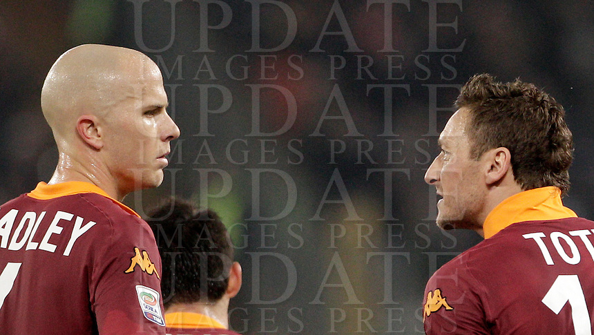 Calcio, Serie A: Roma vs Cagliari. Roma, stadio Olimpico, 1 febbraio 2013..AS Roma forward Francesco Totti talks to teammate Michael Bradley, of the United States, left, during the Italian Serie A football match between AS Roma and Cagliari, at Rome's Olympic stadium, 1 February 2013..UPDATE IMAGES PRESS/Riccardo De Luca