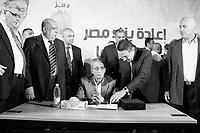 Egypt/ Idku / 18.5.2012 / Amr Moussa surrounded by his team during a rally in Idku, a town nearby Alexandria. May 18th, 2012. Idku, Egypt.<br /> <br /> © Giulia Marchi