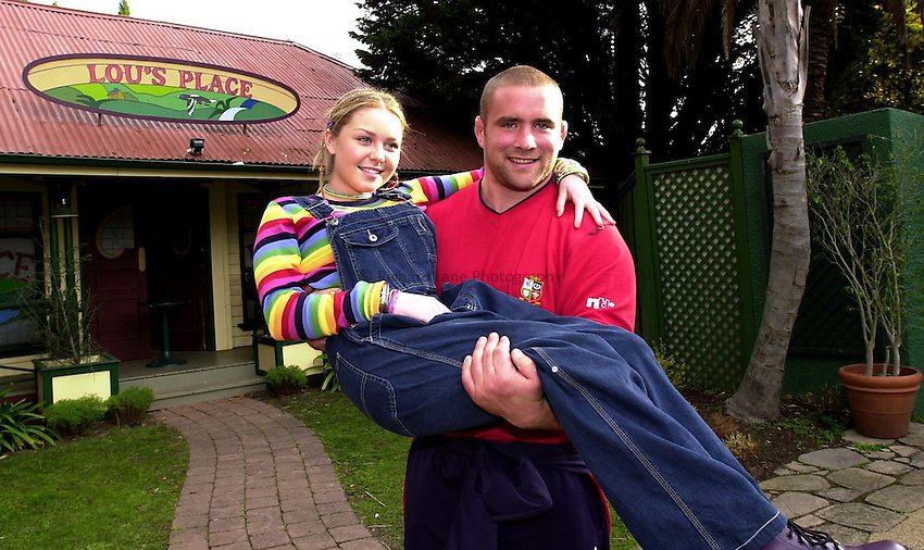 Photo. Richard Lane. .Lions Tour 2001 to Australia. Second Test at, Melbourne, Australia. 5/7/2001.Phil Vickery holds Kate Keltie (aka Michelle Scully) outside Lou's Place on the Neighbours set.