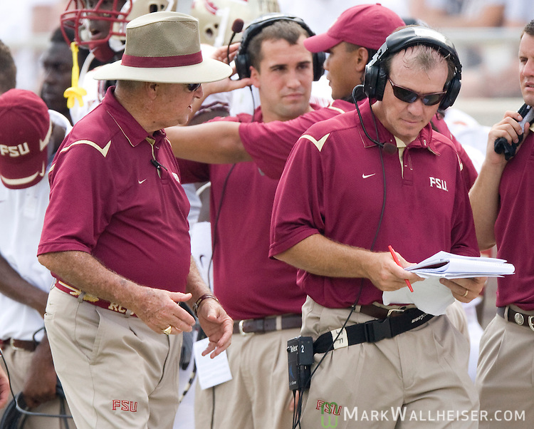 FSU offensive coordinator and head coach in waiting Jimbo Fisher  walks away as head coach Bobby Bowden continues his disagreement in the first half of the Seminoles 17-7 loss to the University of South Florida Bulls in Tallahassee, Florida September 26, 2009 in Valdosta, Georgia. (Mark Wallheiser/TallahasseeStock.com)