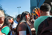 Mayalú Txucarramãe, a female Kayapo leader and activist, negotiates with staff at BNDES, the Brazilian National Development Bank, to arrange a meeting with the management to discuss their greivances after a march from the People's Summit at the United Nations Conference on Sustainable Development (Rio+20), Rio de Janeiro, Brazil, 18th June 2012. Photo © Sue Cunningham.
