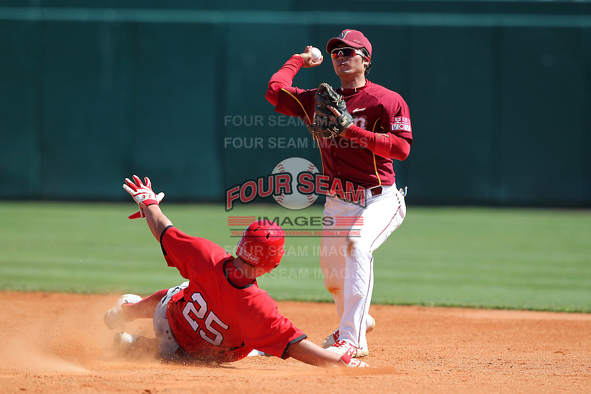 Nexen Heroes infielder Kim Min Woo #7 attempts to turn a double play as Jerod Bartnik #25 slides in during a game vs Team Canada at Al Lang Field in St. Petersburg, Florida;  February 28, 2011.  Canada defeated Nexen 2-0.  Photo By Mike Janes/Four Seam Images
