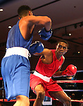 Rahim Gonzales, left, and Jaron Ennis compete in the U.S. Olympic Boxing Trials in Reno, Nev., on Wednesday, Dec. 9, 2015. (AP Photo/Cathleen Allison)