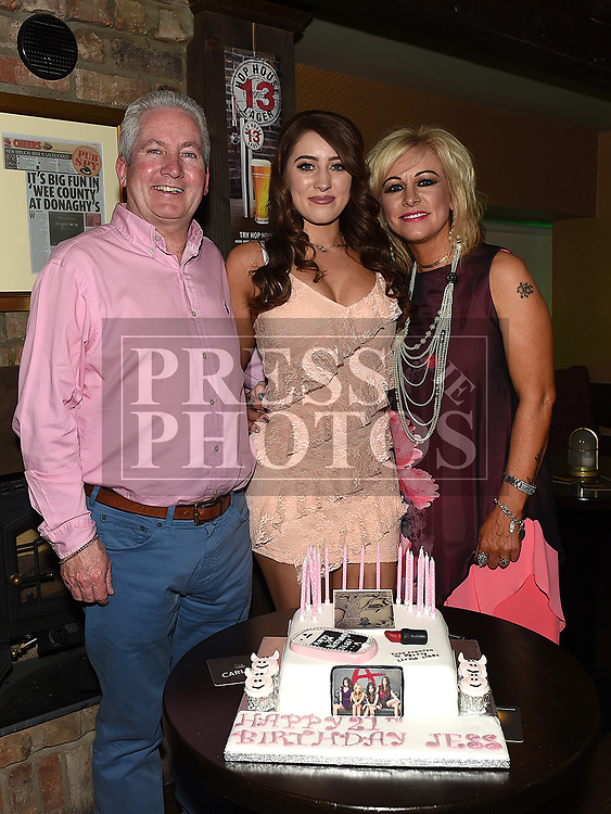 Jess Thompson celebrating her 21st birthday in Donaghy's with parents Seamie and Orla. Photo:Colin Bell/pressphotos.ie