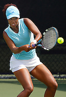 Nikkita Fountain prepares to hit the ball during her doubles match against the University of Miami's Audra Cohen and Melissa Applebaum (ranked number 2) in the second round of the 2006 NCAA Coral Gables Regionals at the Neil Schiff Tennis Center on Saturday, May 13, 2006.  While Fountain and her doubles partner, junior Paula Zabala, managed to keep much of the match close, the Miami pair ultimately broke service and pulled away to win the match 8-4.