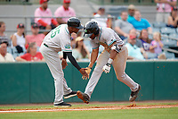 Daytona Tortugas coach Desi Relaford (25) congratulates Malik Collymore (11) after hitting a home run in the top of the fifth inning during a game against the Florida Fire Frogs on April 7, 2018 at Osceola County Stadium in Kissimmee, Florida.  Daytona defeated Florida 4-3 in a six inning rain shortened game.  (Mike Janes/Four Seam Images)
