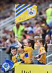Young Clare fans cheer on their team during their Senior quarter final against Tipperary at Pairc Ui Chaoimh. Photograph by John Kelly.