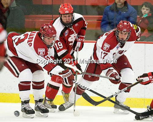 Michael Del Mauro (Harvard - 13), Jeremy Wick (St. Lawrence - 19), Rence Coassin (Harvard - 17) - The Harvard University Crimson defeated the St. Lawrence University Saints 4-3 on senior night Saturday, February 26, 2011, at Bright Hockey Center in Cambridge, Massachusetts.
