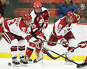 Michael Del Mauro (Harvard - 13), Jeremy Wick (St. Lawrence - 19), Rence Coassin (Harvard - 17) - The Harvard University Crimson defeated the St. Lawrence University Saints 4-3 on senior night Saturday, February 26, 2011, at Bright Hockey Center in Cambridge, Massachusetts.