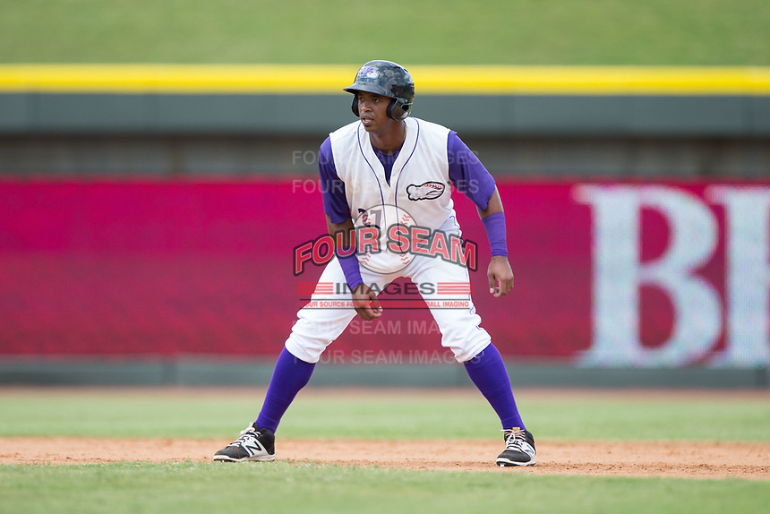 Eloy Jimenez (27) of the Winston-Salem Dash takes his lead off of second base against the Potomac Nationals at BB&T Ballpark on August 6, 2017 in Winston-Salem, North Carolina.  The Nationals defeated the Dash 4-3 in 10 innings.  (Brian Westerholt/Four Seam Images)