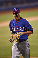 AZL Rangers relief pitcher Rosmer Inojosa (44) jogs off the field between innings of an Arizona League game against the AZL Brewers Blue on July 11, 2019 at American Family Fields of Phoenix in Phoenix, Arizona. The AZL Rangers defeated the AZL Brewers Blue 5-2. (Zachary Lucy/Four Seam Images)