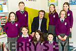 Students from Gaelscoil Faithleann with author Gabriel Fitzmaurice at the opening of the school library on Friday last. <br /> Front l-r Grace Ni Sh&eacute;, D&aacute;ire &Oacute; Briain, Eimear Ni Shuilleabhain, Orianne Nic Giollachudda and Kate Ni Shuilleabhain. <br /> Back l-r Oran Ni Suilleabhain, Gabriel Fitzmaurice, Grainne Ni Bhr&oacute;in and Keira Ni Sh&eacute;imhnigh