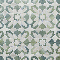 Valencia, a waterjet mosaic, shown in honed Verde Luna and Whitewood, is part of the Miraflores collection by Paul Schatz for New Ravenna.