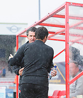 Fleetwood Town manager Joey Barton, left, and Lincoln City manager Danny Cowley<br /> <br /> Photographer Chris Vaughan/CameraSport<br /> <br /> The EFL Sky Bet League One - Lincoln City v Fleetwood Town - Saturday 31st August 2019 - Sincil Bank - Lincoln<br /> <br /> World Copyright © 2019 CameraSport. All rights reserved. 43 Linden Ave. Countesthorpe. Leicester. England. LE8 5PG - Tel: +44 (0) 116 277 4147 - admin@camerasport.com - www.camerasport.com
