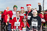Mark O'Shea with Ruairi, Adrienne, Ger and Laura O'Halloran, all from Tralee, pictured at the Santa Fun Run, in aid of Barretstown, starting from the Tralee Bay Wetlands, on Sunday last.
