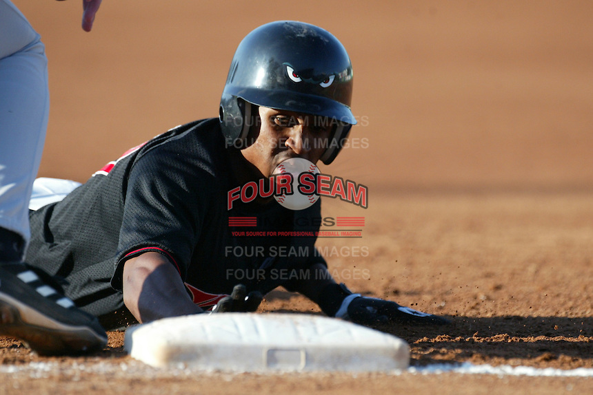 Freddy Guzman of the Lake Elsinore Storm dives back to first base during a game at The Diamond on June 29, 2003 in Lake Elsinore, California. (Larry Goren/Four Seam Images)