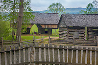 Great Smoky Mts. National Park, TN/NC<br /> View of a cantilever barn and a log corn crib with a  fence at &quot;The Tipton place&quot; farm site in Cades Cove
