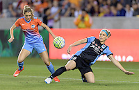 Houston Texas - Kealia Ohai (7) of the Houston Dash attempts to steal the ball from Julie Johnston (8) of the Chicago Red Stars in the first half on Saturday, April 16, 2016 at BBVA Compass Stadium in Houston Texas.  The Houston Dash defeated the Chicago Red Stars 3-1.
