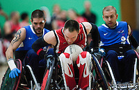 15 AUG 2011 - LEEDS, GBR - Canada's Fabien Lavoie (centre) races for the goal line pursued by Great Britain's Mike Kerr (left) and Jonny Coggan (right) during the wheelchair rugby exhibition match between the two teams (PHOTO (C) NIGEL FARROW)