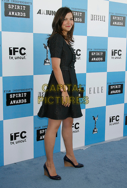 MAGGIE GYLLENHAAL.The 2007 Independent Spirit Awards held at the Santa Monica Pier, Santa Monica, California, USA..February 24th, 2007.full length black dress wedges shoes .CAP/ADM/RE.©Russ Elliot/AdMedia/Capital Pictures