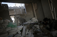In this Tuesday, Oct. 08, 2013 photo, an opposition fighter aims a piece of heavy artillery to the Syrian army position during an attack over Wadi Al-Deef military post at the frontline in Maraat Al-Nouman in the Idlib province countryside of Syria. (AP/Photo)