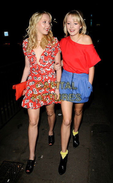 SAMANTHA & AMANDA MARCHANT .The HumanHi Launch Party, Biagio Ristorante, Piccadilly, London, England..May 21st, 2008.full length sam samanda sisters siblings twins family red white black poppy poppies floral print dress clutch bag purse black shoes boots open toe off the shoulder top blue skirt hand in pocket yellow socks plunging neckline ruffled ruffles .CAP/CAN.©Can Nguyen/Capital Pictures.