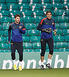 Lionel Messi and Jose Pinto warming up