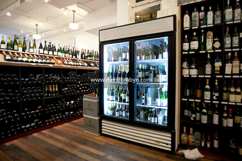 A refrigerated unit keeping wines cold sits in the middle of the Chambers Street Wines store in New York, NY, USA, 22 May 2009. The store specializes in naturally made wines from artisanal small producers and has received a Slow Food NYC Snail of Approval.