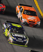 Feb 9, 2008; Daytona, FL, USA; Nascar Sprint Cup Series driver Jimmie Johnson (48) leads Tony Stewart (20) during the Bud Shootout at Daytona International Speedway. Mandatory Credit: Mark J. Rebilas-US PRESSWIRE